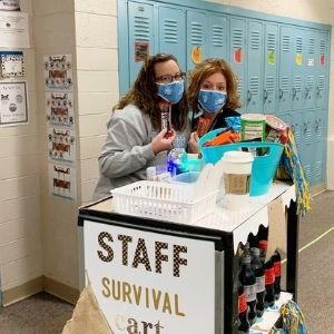 Staff members posing with Staff Survival Cart